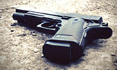 Gun-wielding woman saves husband from armed robbers